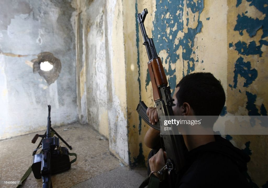 A member of Lebanon's Hezbollah group takes position on the rooftop of a building in a Shiite Muslim neighbourhood of the capital Beirut on October 22, 2012. Lebanon's army said it was determined to restore order in Lebanon, roiled by growing political tensions linked to Syria after a top policeman was murdered and former premier Saad Hariri called for the government to step down. AFP PHOTO/STR