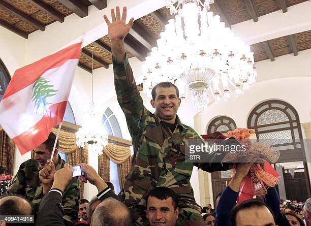 A member of Lebanons security forces who was kidnapped by jihadist groups in early August 2014 in the eastern border town of Arsal celebrates his...