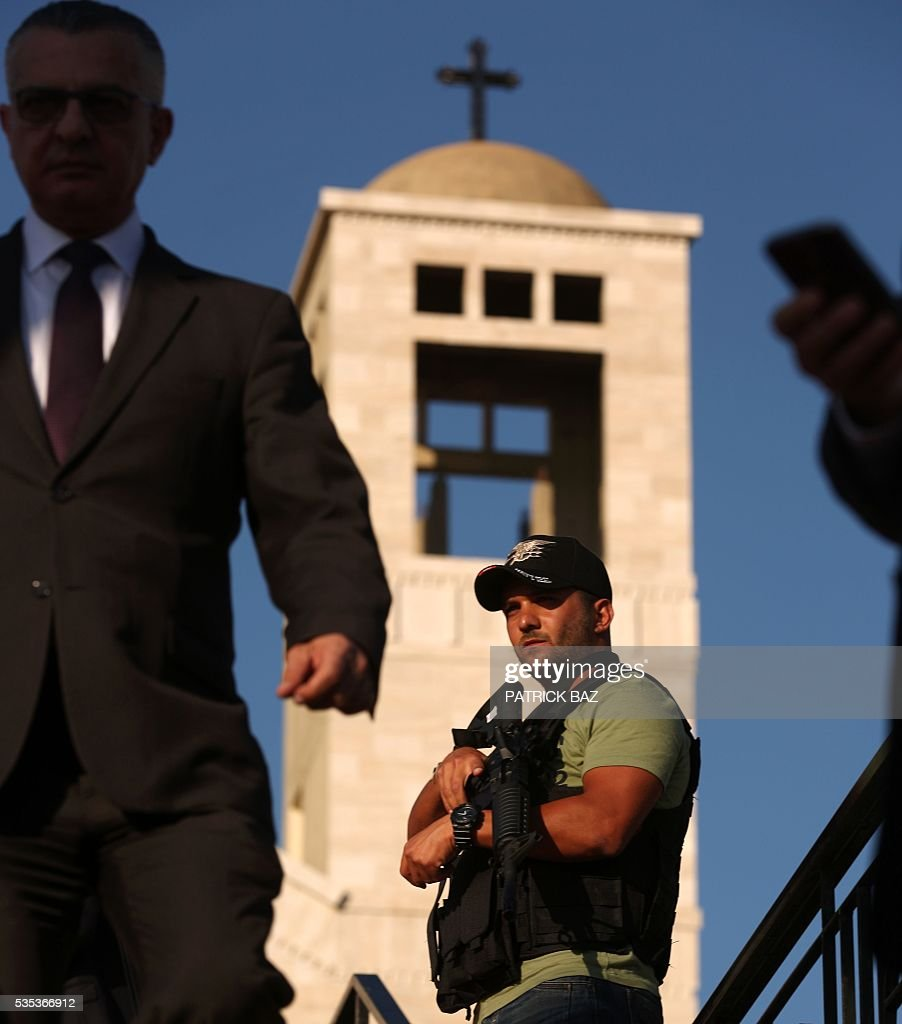 A member of Lebanon's State Security apparatus stands guard in front of the Basilica of Our Lady of Mantara in the southern Lebanese town of Maghdouche East of Sidon, on May 29, 2016 during the launching of an event by the Ministry of Tourism to put the Grotto of Maghdouche on the international religious tourism map. Magdouche, along with Lourdes in France, Fatima in Portugal and Medugorje in Bosnia & Herzegovina are expected to be put on the international religious tourism map. According to local tradition the Virgin Mary accompanied Jesus during his journey to Tyre and to Sidon and waited for him in the grotto at Magdoucheh. The grotto was discovered 400 years ago. / AFP / Patrick BAZ