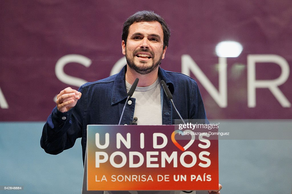 Member of left wing alliance party Unidos Podemos 'United We Can' Alberto Garzon addresses supporters during a rally ahead of Spanish General Elections on June 24, 2016 in Madrid, Spain. Spanish voters head back to the polls on June 26 after the last election in December failed to produce a government. Latest opinion polls suggest the Unidos Podemos 'United We Can' left-wing alliance could make enough gains to come in second behind the caretaker government of the center-right Popular Party.