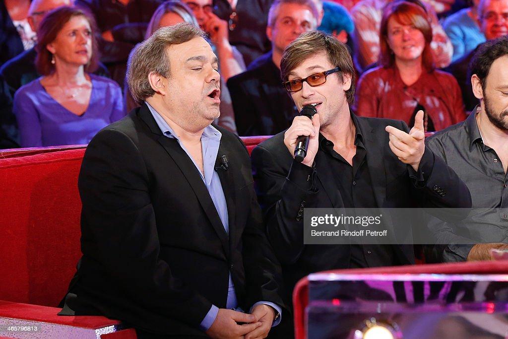 Member of 'Les Inconnus' Didier Bourdon and singer Thomas Dutronc sing the song written by 'Les Inconnus' 'Isabelle a les yeux bleu' attending the...