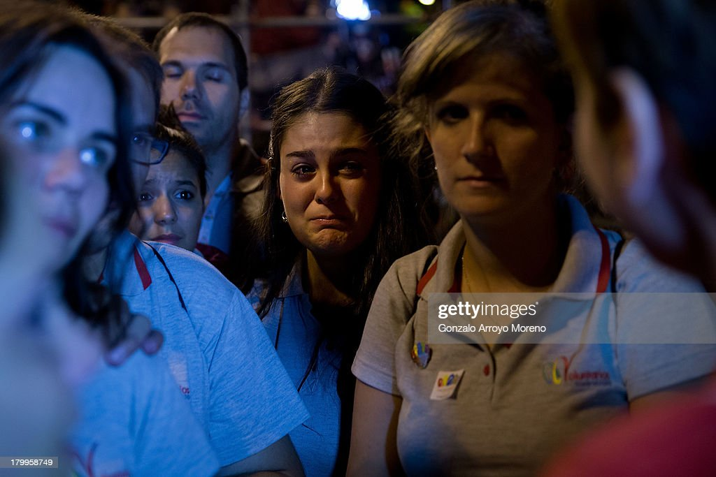 A member of Madrid 2020 Olympic bid staff cries as her boss tells her how Madrid 2020 Candidancy has been eliminated at Puerta de Alcala on September 7, 2013 in Madrid, Spain.