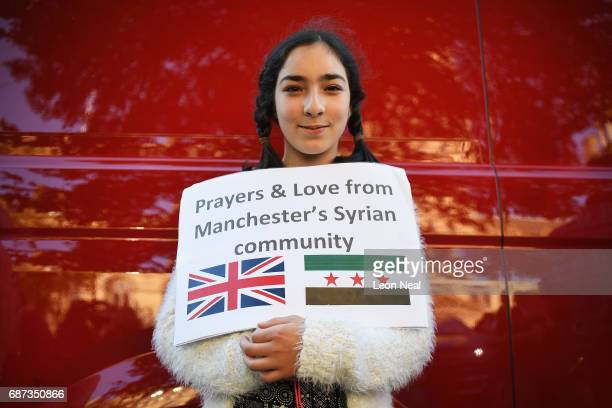 A member of Manchester's Syrian community attends a vigil to honour the victims of Monday evening's terror attack at Albert Square on May 23 2017 in...