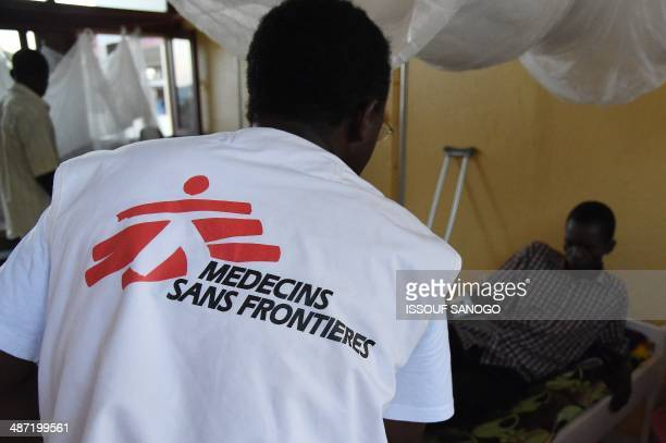A member of Medecins Sans Frontieres takes care of a wounded man on April 28 at Bangui's general hospital At least 22 people including three staff...