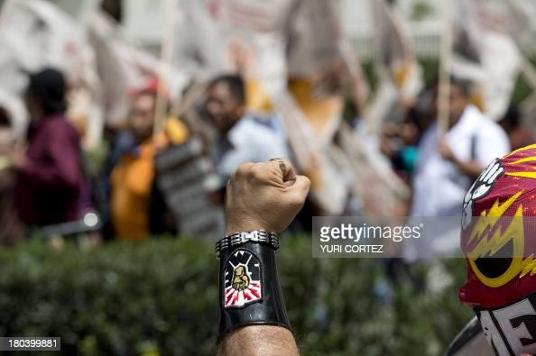 A member of Mexican Electrical Workers union rises his fist during a rally at Reforma avenue in Mexico City on September 12 2013 Different civil...