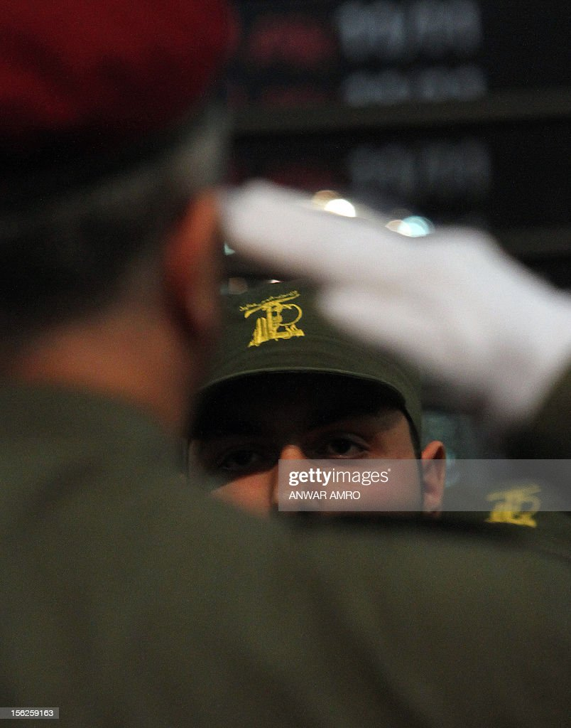 A Member of militant Shiite Muslim group Hezbollah salutes his comrade on the occastion of the party's Martyrs' Day in southern Beirut, on November 12, 2012.