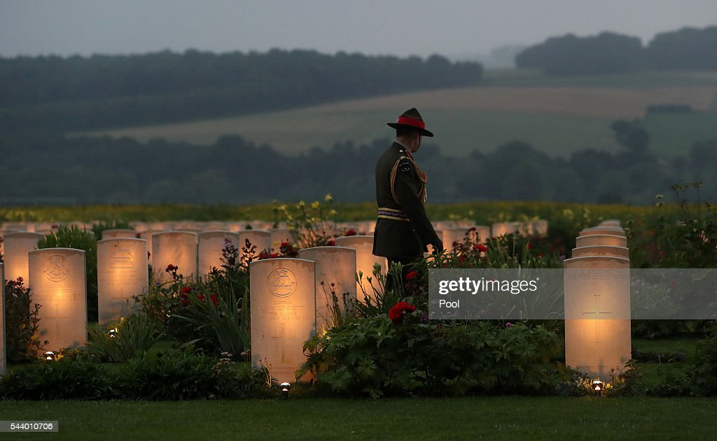 A member of Military personnel looks a war graves during part of a military-led vigil to commemorate the 100th anniversary of the beginning of the Battle of the Somme at the Thiepval memorial to the Missing on June 30, 2016 in Thiepval, France. The event is part of the Commemoration of the Centenary of the Battle of the Somme at the Commonwealth War Graves Commission Thiepval Memorial in Thiepval, France, where 70,000 British and Commonwealth soldiers with no known grave are commemorated.