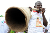 A member of Nasarawa cultural troupe blows traditional flute to herald the arrival of President Goodluck Jonathan at the Lafia Township Stadium to...