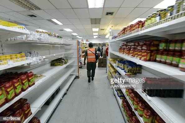 Member of national guard patrols a supermarket in Caracas on February 3 2015 President Nicolas Maduro whose country faces severe economic crisis and...