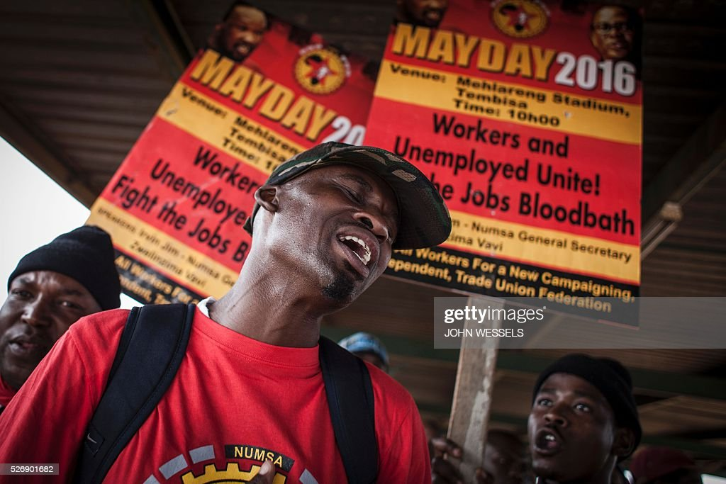 A member of National Union of Metalworkers of South Africa (NUMSA), one of the biggest South African unions that was expelled from the main South African Trade Unions Federation (COSATU), cheers during a May Day rally organized by a new United Front South African labour movement at Tembisa stadium on May 1, 2016 in Tembisa. Vavi was expelled from Cosatu in March 2015 for bringing it into disrepute and causing divisions by speaking out against the ANC governments policies and saying it had failed workers. He had since launched a new union federation to rival Cosatu. / AFP / JOHN