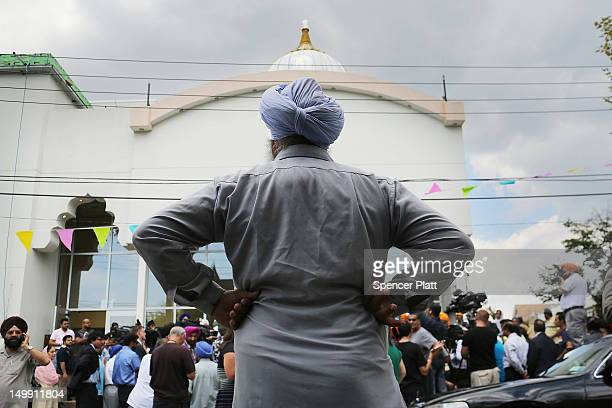 A member of New York's Sikh community listens as New York Mayor Michael Bloomberg and Police Commissioner Raymond Kelly hold a news conference after...