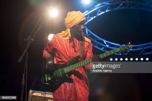 A member of Nigerian Muhtar Gomara music band performs during the 14th International Nomads Festival in M'Hamid El Ghizlane town of Zagora Morocco on...