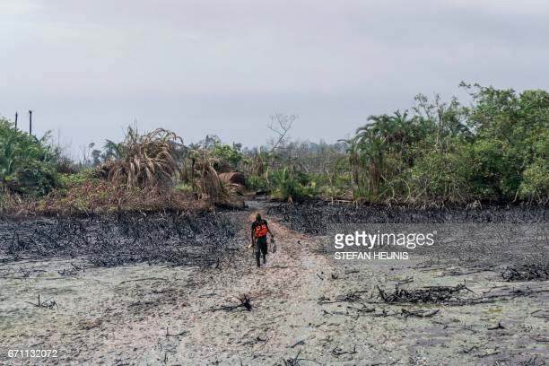 A member of NNS Pathfinder of the Nigerian Navy forces walks through a mangrove during a patrole looking for illegal oil refineries on April 19 2017...