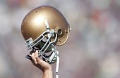 A member of Notre Dame Fighting Irish holds up his helmet on the opening kickoff during the game against the Stanford Cardinal on October 7 2006 at...