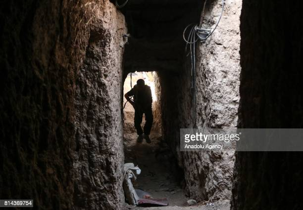 A member of opposition forces is seen during a clash after Assad Regime's forces hit a deconflict zone of opposition controlled Jobar neighborhood in...