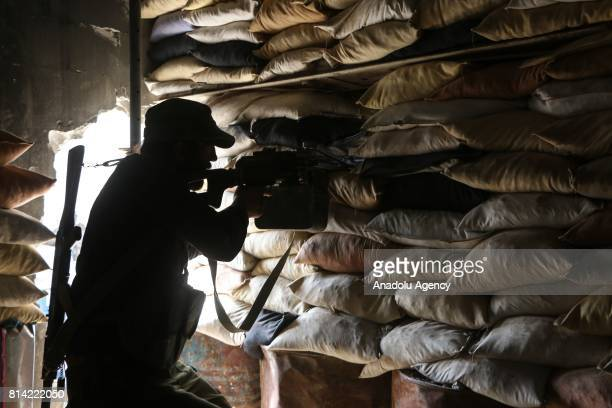 A member of opposition forces is seen in a bulwark during a clash after Assad Regime's forces hit a deconflict zone of opposition controlled Jobar...