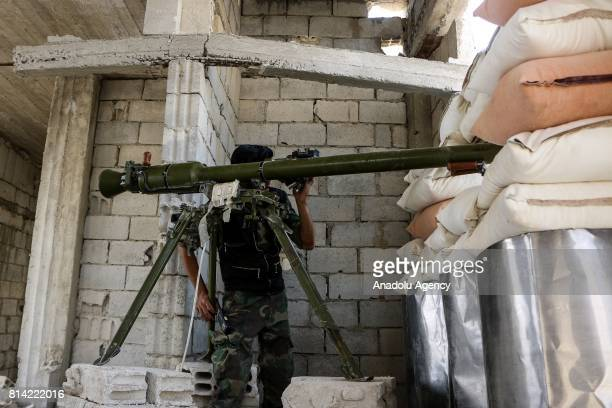 A member of opposition forces looks through a scope during a clash after Assad Regime's forces hit a deconflict zone of opposition controlled Jobar...