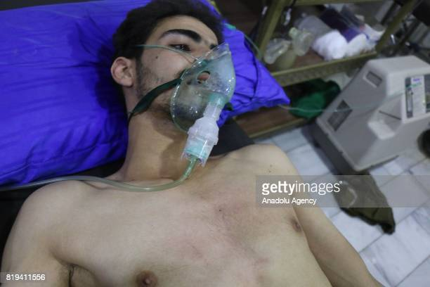 A member of opposition forces receives medical treatment after Assad regime's alleged chemical gas attack over oppositions' frontline where is...