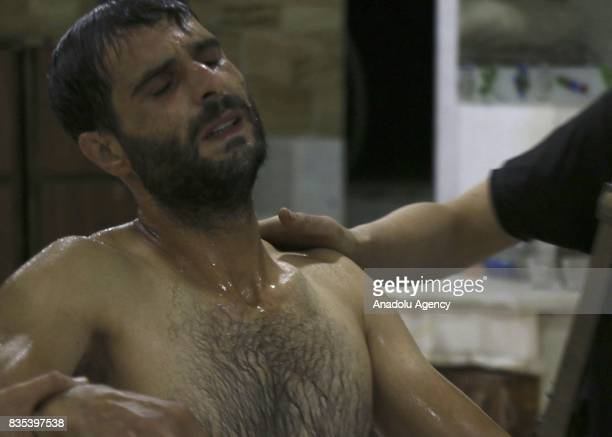 A member of opposition forces receives medical treatment at a field hospital after Assad regime's alleged poisonous gas attack over oppositions'...