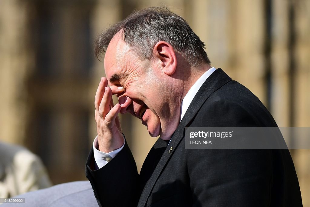 Member of Parliament and former Scottish first minister Alex Salmond reacts as he speaks to journalists in central London on June 27, 2016. Britain's historic decision to leave the 28-nation bloc has sent shockwaves through the political and economic fabric of the nation. It has also fuelled fears of a break-up of the United Kingdom with Scotland eyeing a new independence poll, and created turmoil in the opposition Labour party where leader Jeremy Corbyn is battling an all-out revolt. / AFP / Leon NEAL