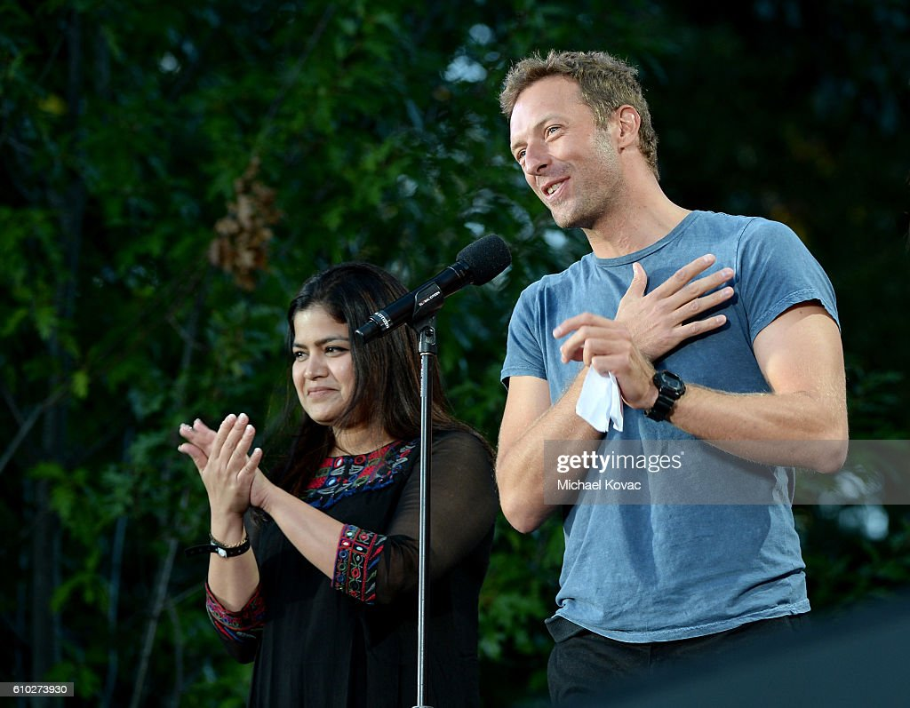 Member of Parliament from Mumbai North Central Poonam Mahajan and musician Chris Martin present onstage at the 2016 Global Citizen Festival in Central Park To End Extreme Poverty By 2030 at Central Park on September 24, 2016 in New York City.