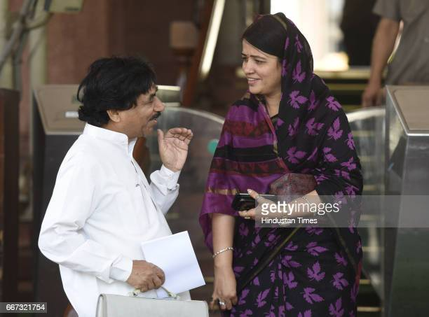 Member of Parliament from Ujjain constituency of Madhya Pradesh Satyanarayan Jatiya talking to Lok Sabha MP from Sidhi of Madhya Pradesh Riti Pathak...