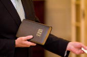 A member of parliament swears on a Bible as the Australian Labor Party is sworn in by GovernorGeneral Quentin Bryce on September 14 2010 in Canberra...