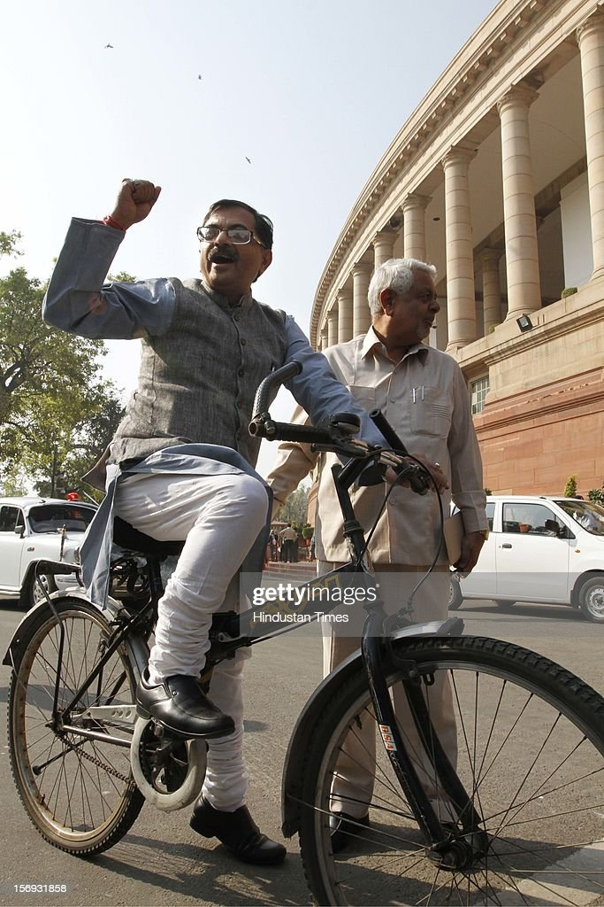 Member of Parliament Tarun Vijay arrives at the Parliament House on bicycle, in protest against the Congress-led United Progressive Alliance (UPA) government on Foreign Direct Investment (FDI), for the Winter Session of Parliament on November 22, 2012 in New Delhi, India. Parliament's winter session began on a stormy note as the issue of FDI in trade and reservation for ST/SC in promotion disrupted the Lok Sabha and Rajya Sabha.