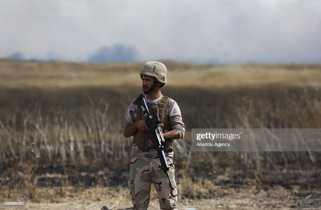 A member of Peshmerga forces stands guard as Peshmerga forces conduct an operation against Daesh terrorists in Nineveh, Iraq on May 30, 2016.