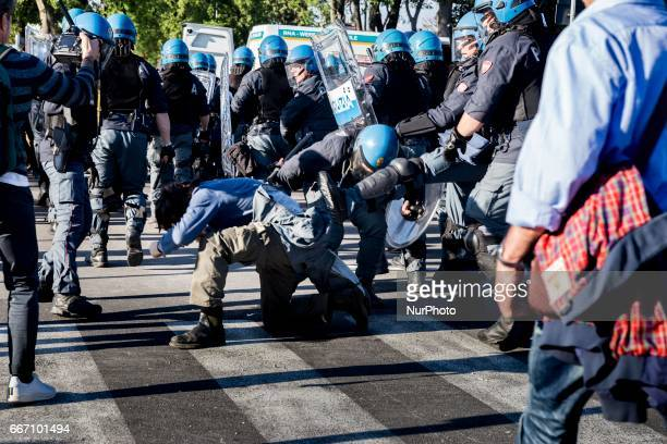 A member of police attack a demonstrators during clashes with riot police in Lucca Italy on April 10 2017 during a demonstration against G7 Foreign...