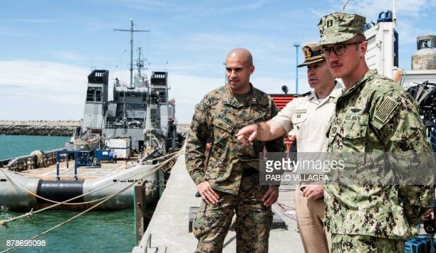 A member of Prefectura Naval Argentina talks with US Navy Karl Schonberd in Comodoro Rivadavia Chubut Argentina on November 24 2017 President...