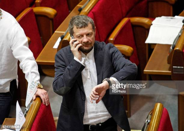 A member of quotRadical Partyquot Igor Mosiychuk speaks on the phoneduring the Ukrainian Parliament session in Kiev Ukraine 07 February 2017 The...