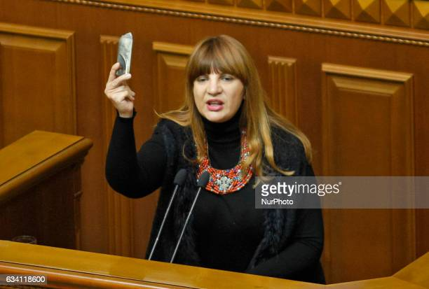 A member of quotRadical Partyquot Oksana Korchynska shows for lawmakers a part of a shell from Avdiivkaduring the Ukrainian Parliament session in...
