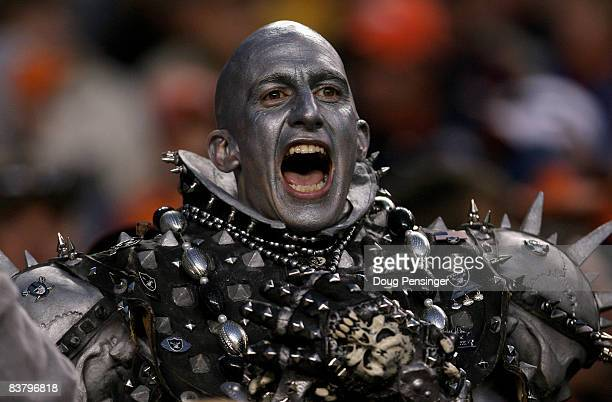 A member of Raider Nation shows his support of the Oakland Raiders as they faced the Denver Broncos during week 12 NFL action at Invesco Field at...