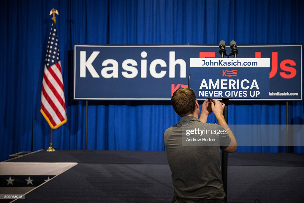 A member of Republican presidential hopeful, Ohio Gov. John Kasich's campaign prepares the room for Kasich's primary night gathering on February 9, 2016 in Concord, New Hampshire. Kasich is hoping to upset fellow Republican governor candidate Chris Christie and Jeb Bush with strong poll numbers.