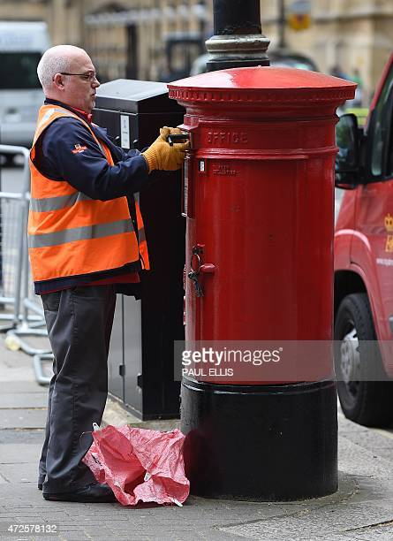 A member of Royal Mail staff seals up a post box in central London on May 8 2015 AFP PHOTO / PAUL ELLIS