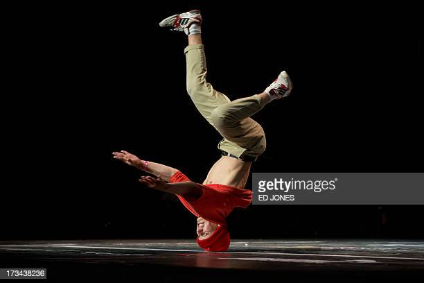A member of Russian crew 'Slavic United' competes in the quarter final round of the R16 World BBoy Masters Championships in Seoul on July 14 2013...