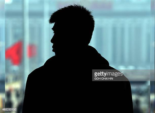 A member of security stands guard during the opening of the 3rd Session of the 12th National People's Congress at the Great Hall of the People in...