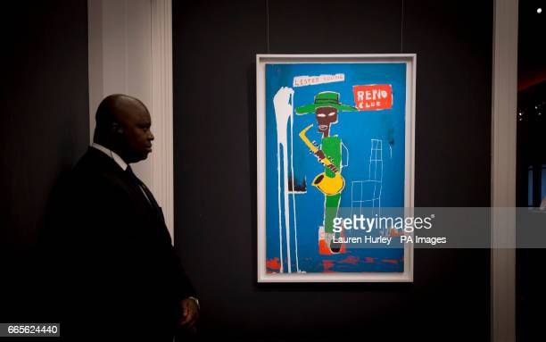 A member of security watches over 'In the Wings 1986' by jeanMichel Basquiat estimated at five to seven million dollars at Sotheby's in London during...