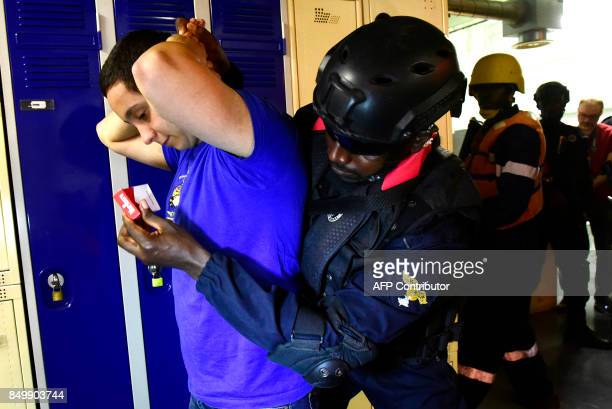 A member of Senegal's marines special forces searches a crew member of the 'Casimir' a trawler suspected of illegal fishing during a mock exercise on...