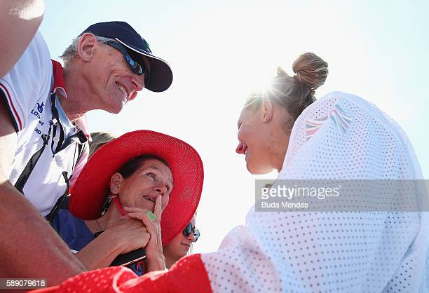 A member of silver medalists Great Britain celebrates after the medal ceremony for the Women's Eight on Day 8 of the Rio 2016 Olympic Games at the...