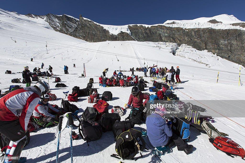 Member of ski teams having a break on the bottom station of the t-bar lift on the Fee glacier on September 13, 2013 in Saas-Fee, Switzerland.