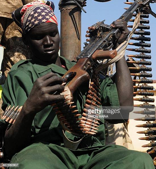 A member of South Sudan's former rebel army the Sudan People's Liberation Army adjusts his machine gun in the key north oil city of Bentiu after...