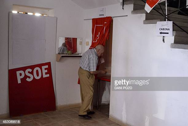 A member of Spain's Socialist Party prepares to cast his ballot at a polling station in Madrid on July 13 2014 After humiliating election defeats...