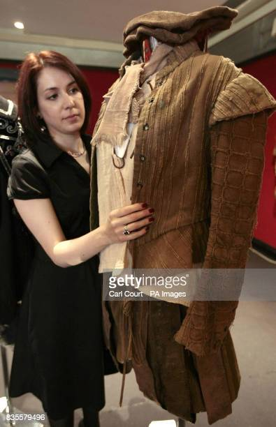 A member of staff at Bonhams Knightsbridge showroom adjusts the costume worn by Tony Robinson in his role as Baldrick in Blackadder II at the...