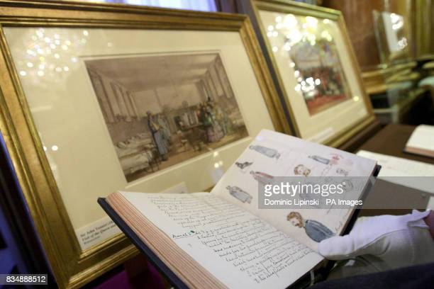 A member of staff at Buckingham Palace holds a journal written by Queen Victoria in 1855 documenting her visit to meet a British soldier who was...