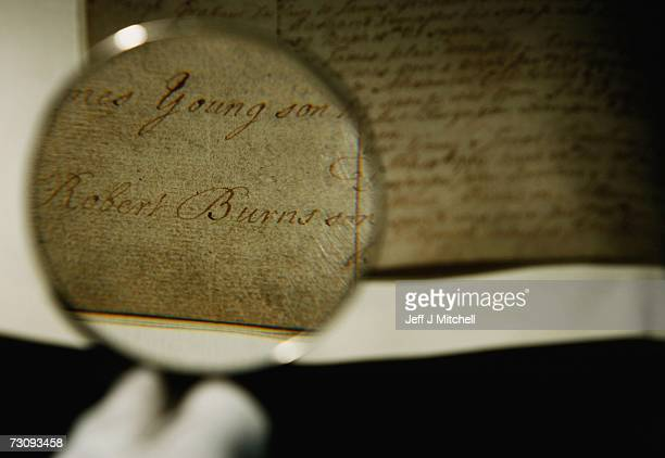 A member of staff at the General Register Office for Scotland holds the birth certificate of Robert Burns January 242006 Edinburgh in Scotland The...
