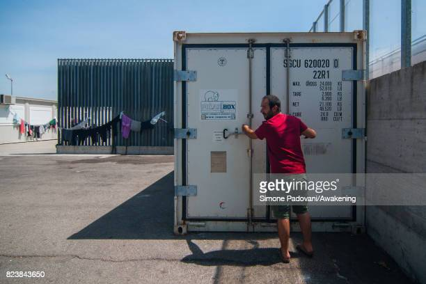 A member of staff checks the polar box where luggage is disinfected on the arrival of the asylum seekers on July 27 2017 in Bologna Italy In an...