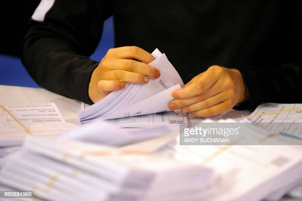 A member of staff counts ballots at the main Glasgow counting centre in Emirates Arena in Glasgow Scotland on June 8 after the polls closed in...