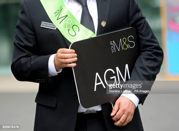 A member of staff directs Marks and Spencer shareholders as they queue to get in to the MS Annual General Meeting at the Royal Festival Hall on the...